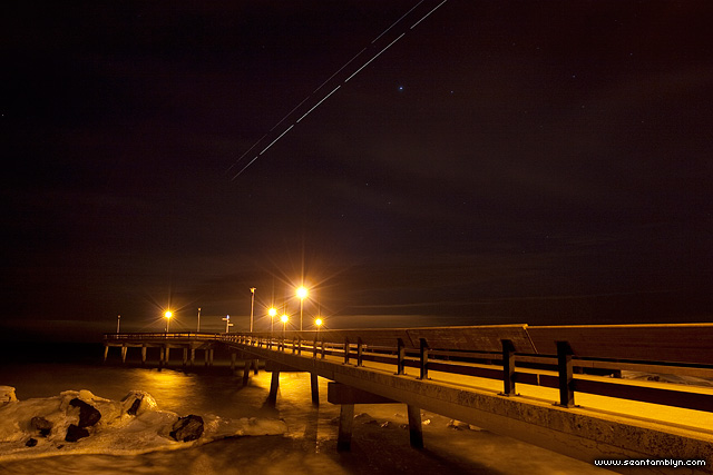Space shuttle Discovery and ISS over pier, Centre Island, Toronto Islands