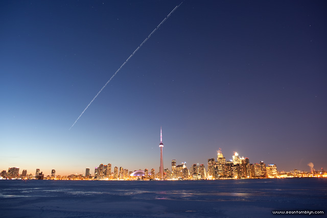 Space shuttle Discovery and ISS over Toronto skyline, Centre Island, Toronto Islands
