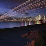 Aircraft trails over Toronto skyline, Ward's Island, Toronto Islands