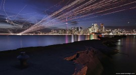Aircraft trails over Toronto skyline, Ward&#039;s Island, Toronto Islands