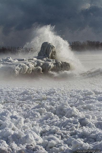 Waves break over ice covered breakwall, Ward's Island, Toronto Islands