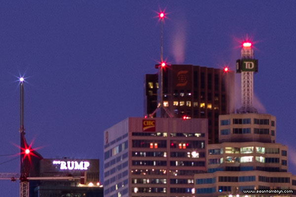 Trump logo glowing during Earth Hour 2016, seen from Centre Island, Toronto Islands