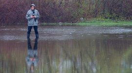 City TV reporter in floodwaters, Ward's Island, Toronto Islands