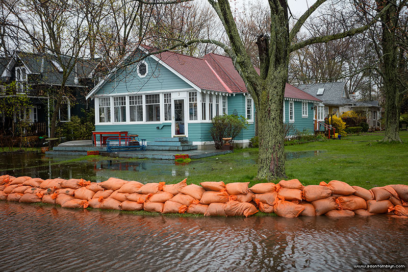 Floodwaters and sandbags in front of 3 Seneca Ave, Algonquin Island, Toronto Islands