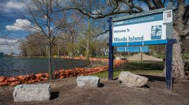Welcome to Ward's Island sign with sandbags, Ward's Island, Toronto Islands