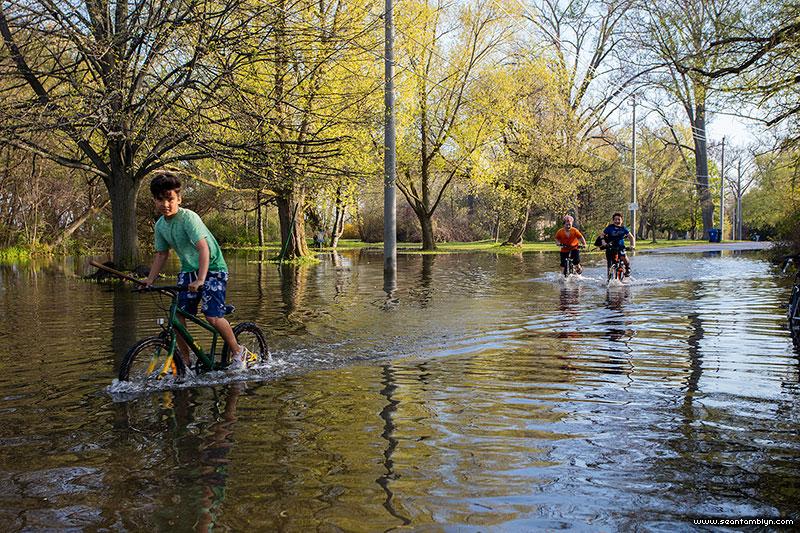 Biking through the flood along Cibola Ave, Toronto Islands