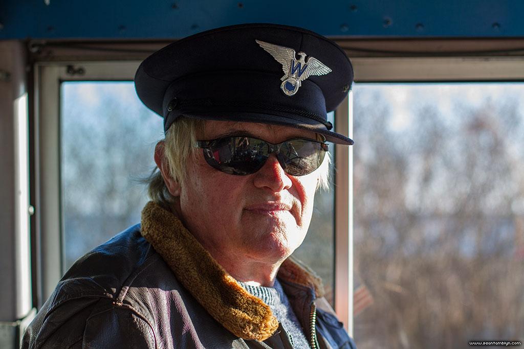 Manuel in bus driver chic on aboard the Jimmy Jones Express, Ward's Island, Toronto Islands