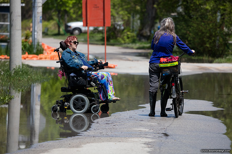 Talking in the floodwaters on Cibola Ave, Flood of 2017, Algonquin Island, Toronto Islands