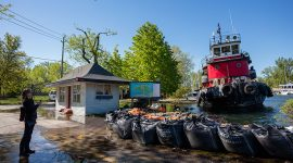 Tugboat Radium Yellowknife delivering sandbags, Ward's Island, Toronto Islands