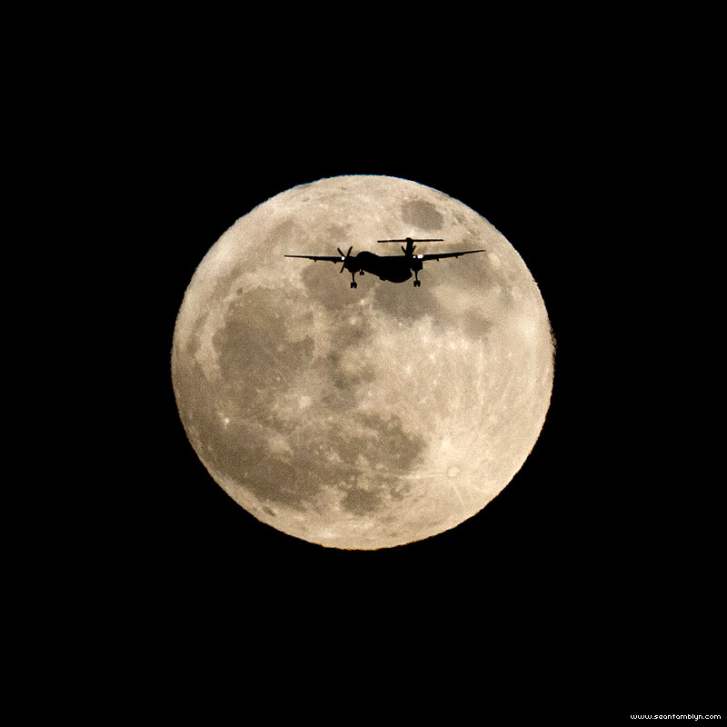 Bombardier Q400 in front of super moon, Ward's Island, Toronto Islands