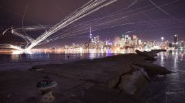 Long exposure aircraft trails over Toronto skyline, Ward's Island, Toronto Island