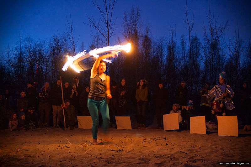 Fire hooping in front of the fire, Equinox Bonfire 2018, Ward's Island, Toronto Islands