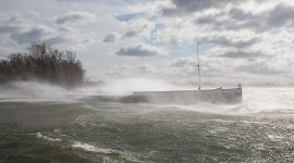 High winds push waves over the Rapids Queen, Algonquin Island, Toronto Islands