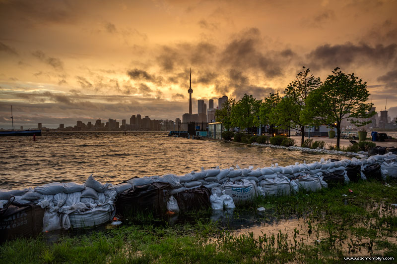 Stormclouds over sandbags in front of ferry docks, Ward's Island, Toronto Islands