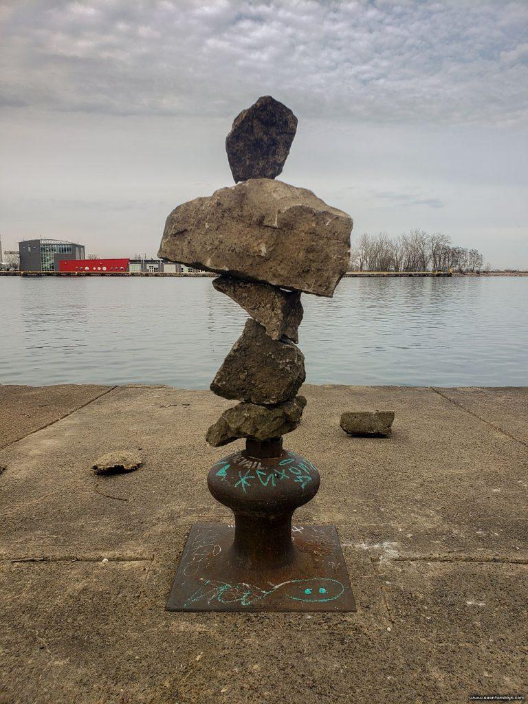 Rocks balanced on bollard, Eastern Gap, Ward's Island, Toronto Islans