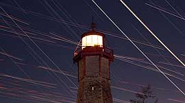 Venus and Jupiter conjunction with star and aircraft trails, Gibraltar Lighthouse, Toronto Islands
