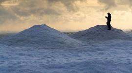 Photographer on ice mountains, Ward's Island, Toronto Islands