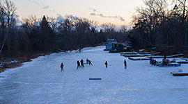 Twilight hockey game on lagoon ice, Algonquin Island, Toronto Islands