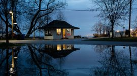 Waiting shed reflected in Lake Wards at dusk, Ward's Island, Toronto Islands