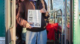 Jimmy Jones holding copy of Torontos Riviera of Yesteryear, Ward's Island, Toronto Islands