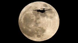 Bombardier Q400 in front of super moon, Ward's Island, Toronto Islands