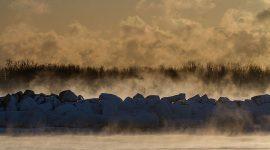 Heavy steam rises above the break wall, Ward's Beach, Toronto Islands