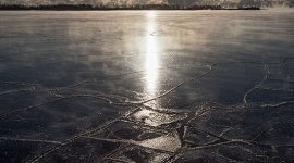 Sunrise over fresh ice in front of the Leslie St Spit, Center Island, Toronto Islands