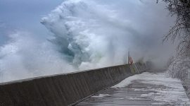 Wave exploding against breakwall, Boardwalk, Toronto Islands