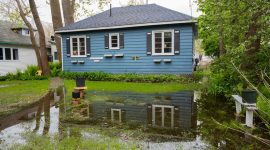 Floodwaters encroach on number 4 Channel Ave., Ward's Island, Toronto Islands