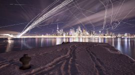 Long exposure aircraft trails over Toronto skyline, Wards Island, Toronto Islands