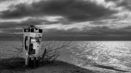 Phone booth at water's edge under stormy skies, Gibraltar Point, Hanlan's Point, Toronto Islands